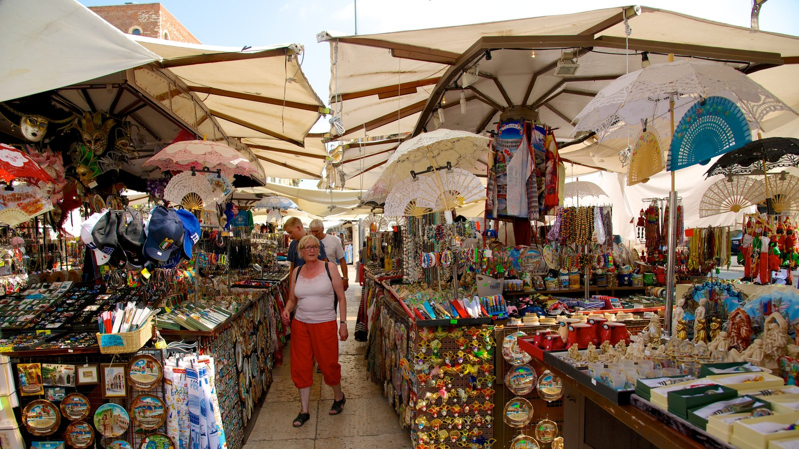 Piazza delle Erbe which includes street scenes and markets as well as a small group of people