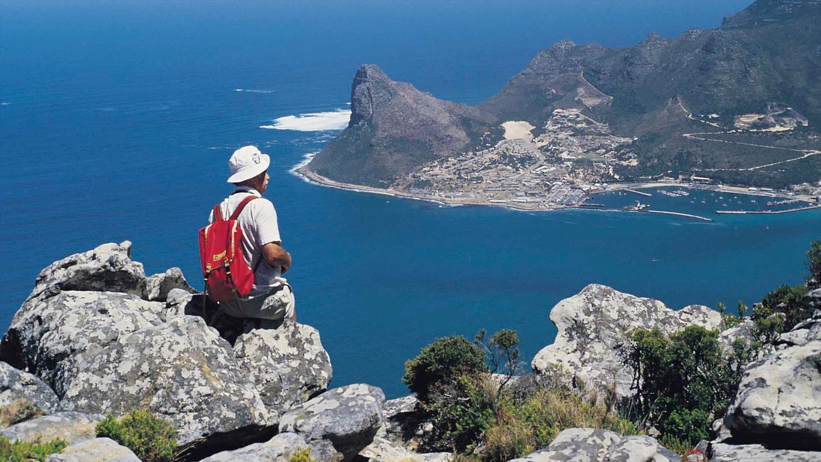 Hout Bay Beach which includes landscape views, hiking or walking and general coastal views