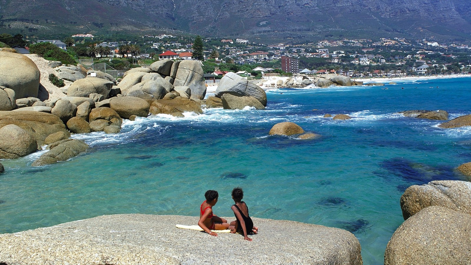 Camps Bay which includes landscape views, rugged coastline and a bay or harbor