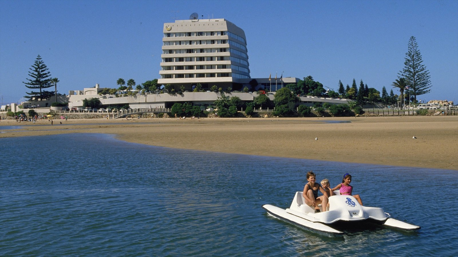 Plettenberg Bay featuring a bay or harbor, a beach and a coastal town