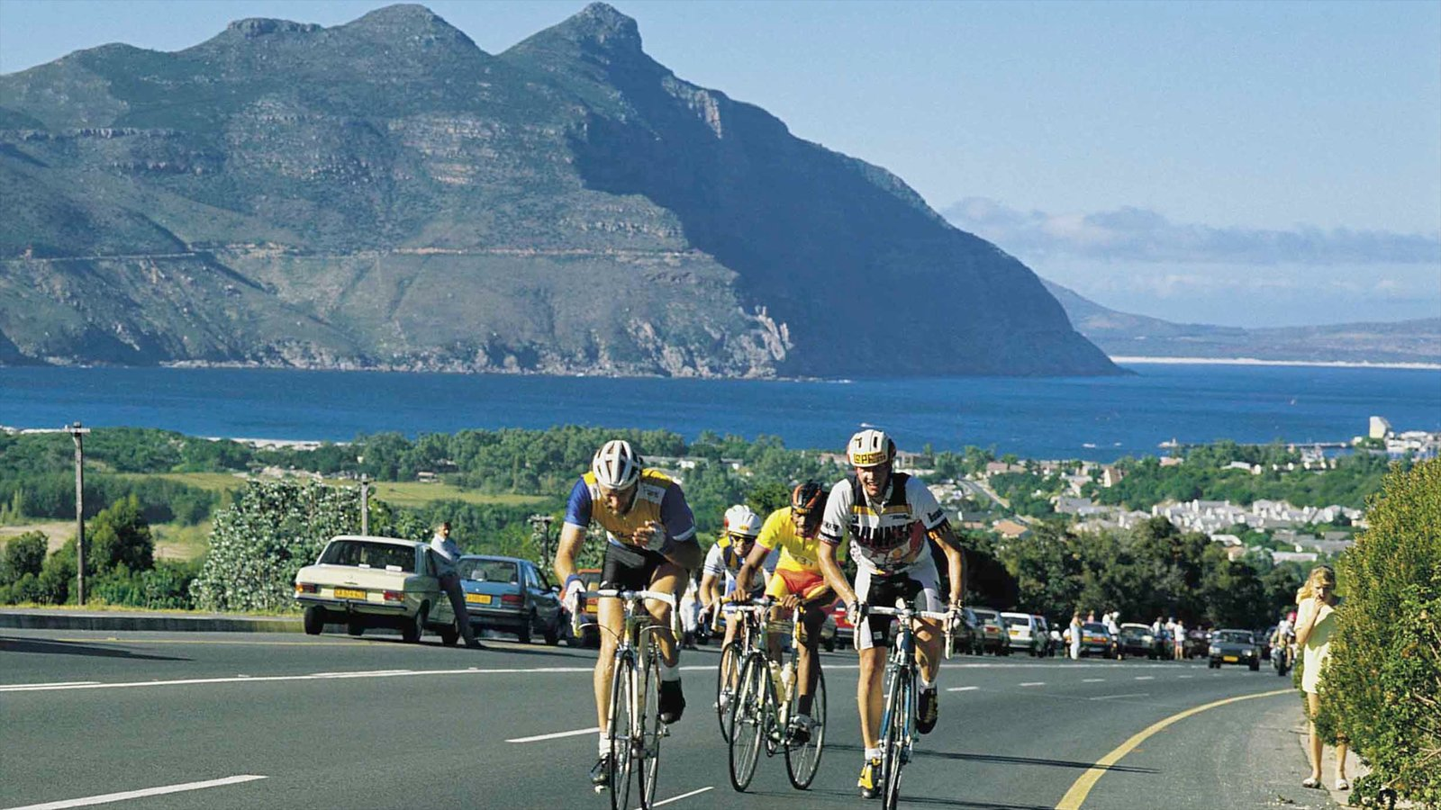 Hout Bay Beach showing a bay or harbour, general coastal views and road cycling