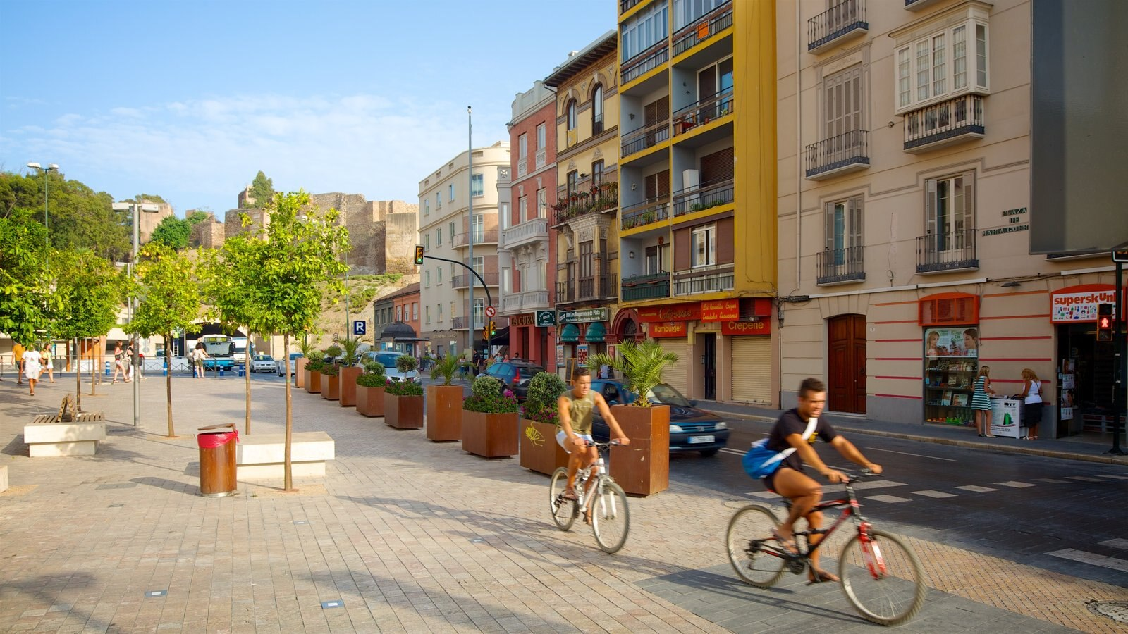 Malaga showing cycling as well as a couple