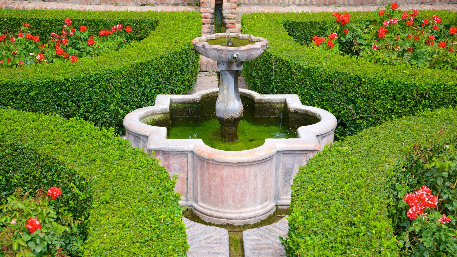 Alcazaba which includes a fountain, flowers and a garden