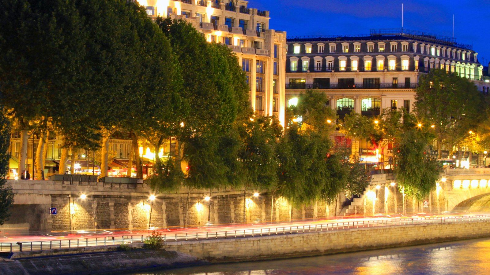 Paris which includes heritage architecture, night scenes and a river or creek