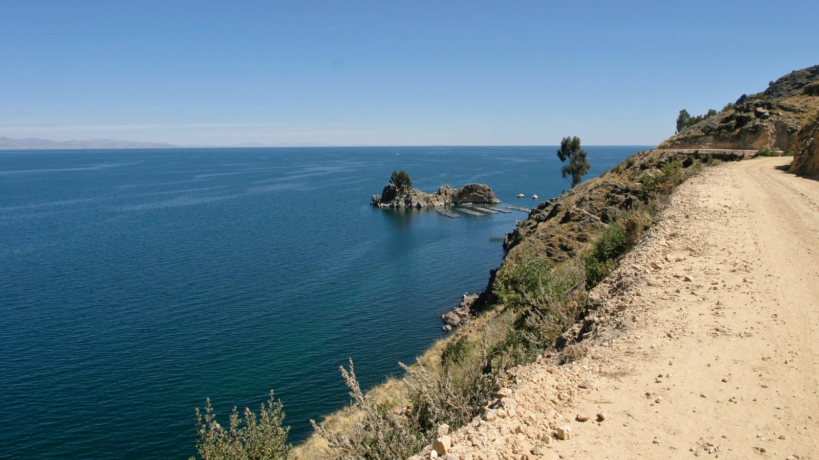 Lake Titicaca - Puno which includes landscape views and general coastal views