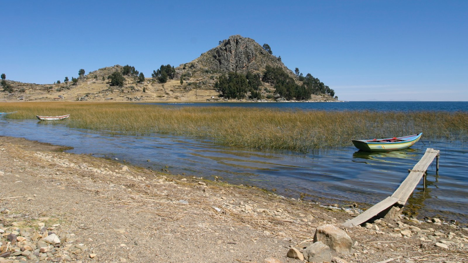 Lake Titicaca - Puno featuring a lake or waterhole, kayaking or canoeing and general coastal views