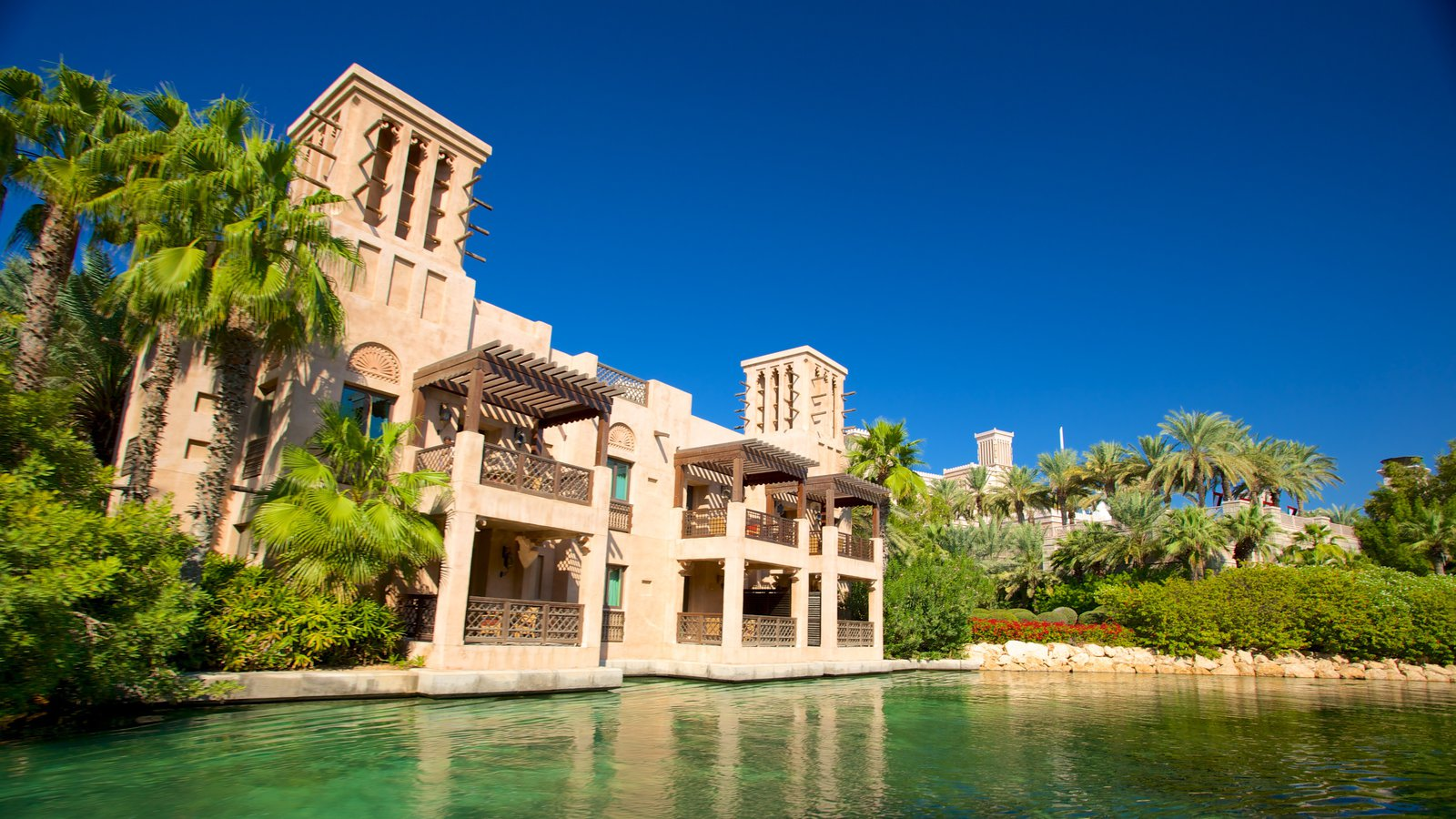 Souk Madinat Jumeirah showing tropical scenes, a pond and a house
