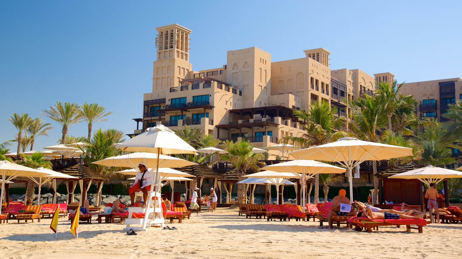 Souk Madinat Jumeirah which includes a beach, a luxury hotel or resort and tropical scenes