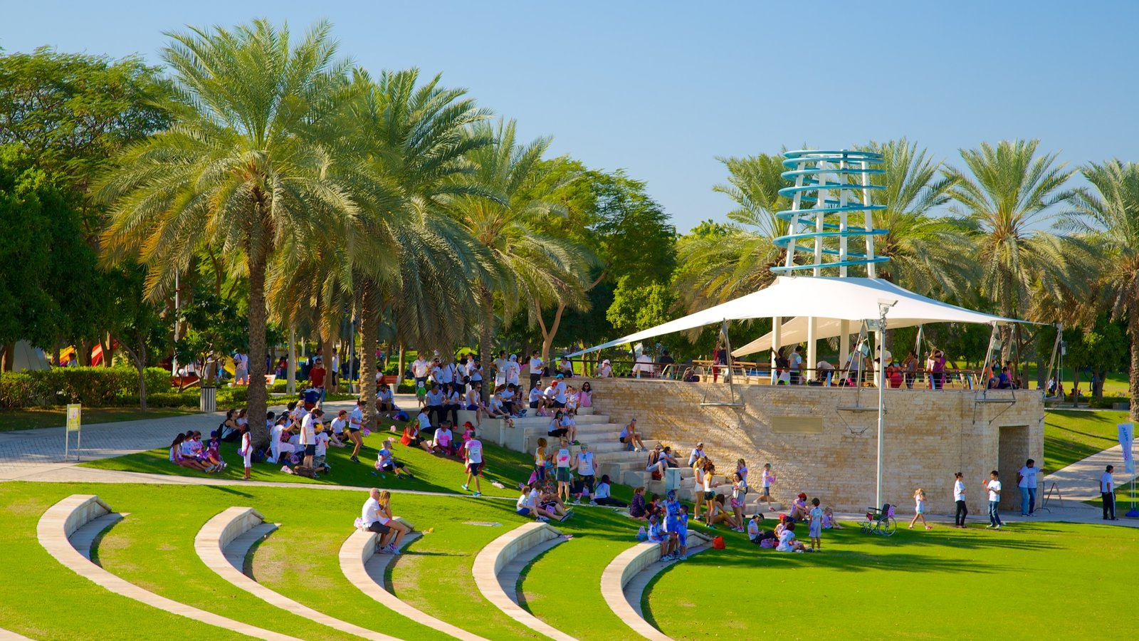 Zabeel Park featuring a park as well as a large group of people