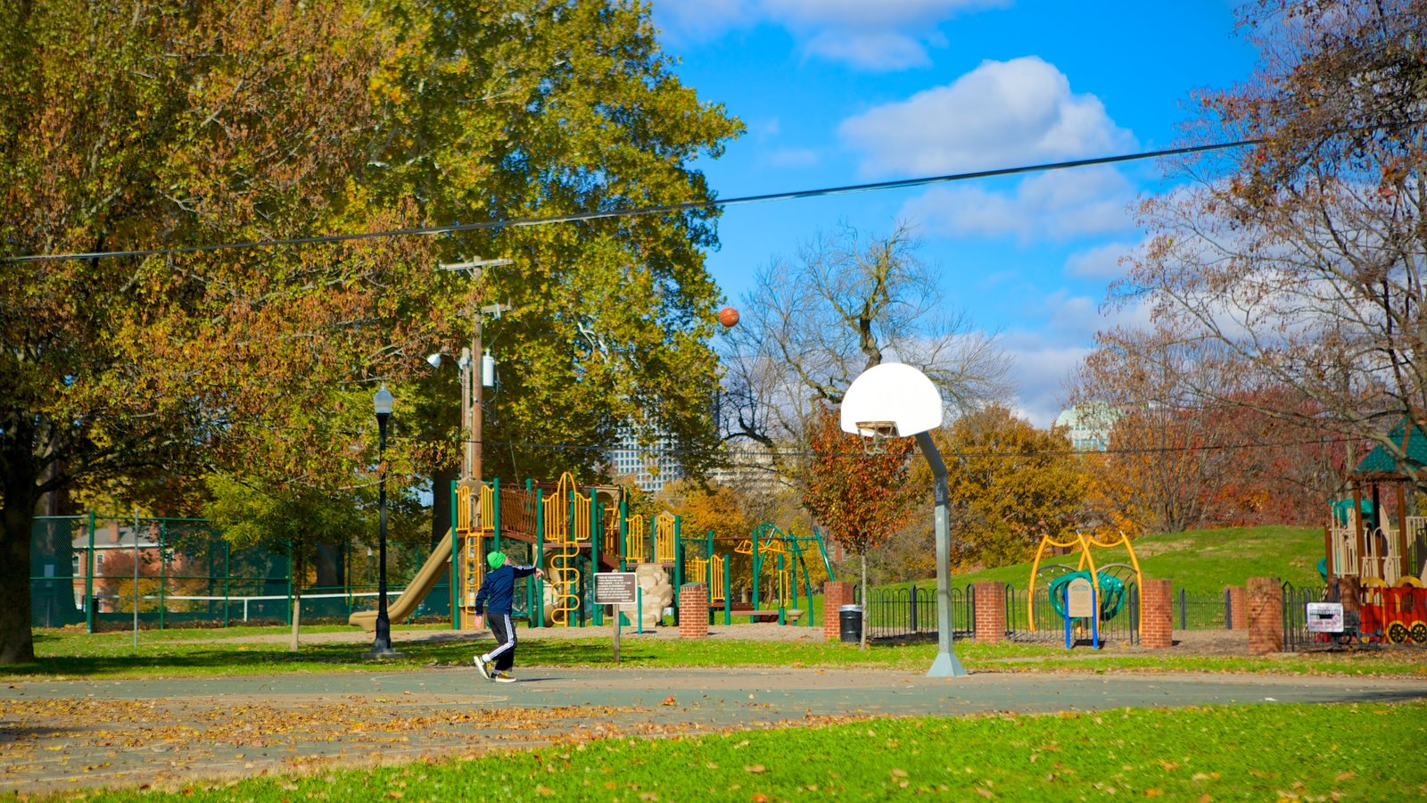 Schiller Park showing a playground and a park as well as an individual child
