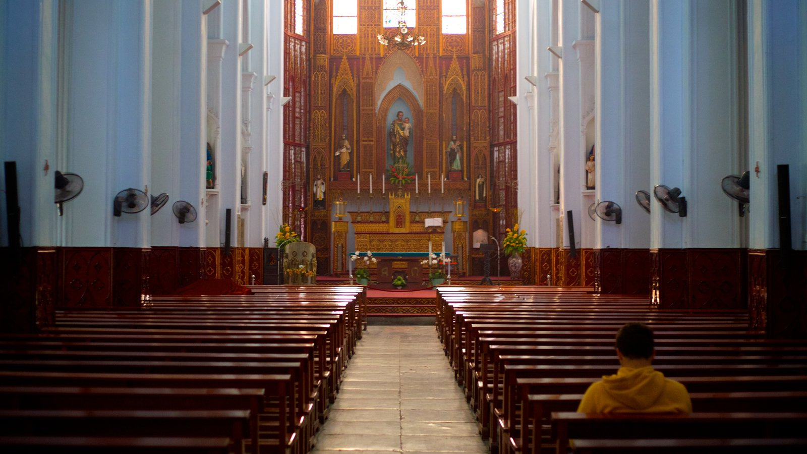 St. Joseph Cathedral featuring religious elements, a church or cathedral and interior views