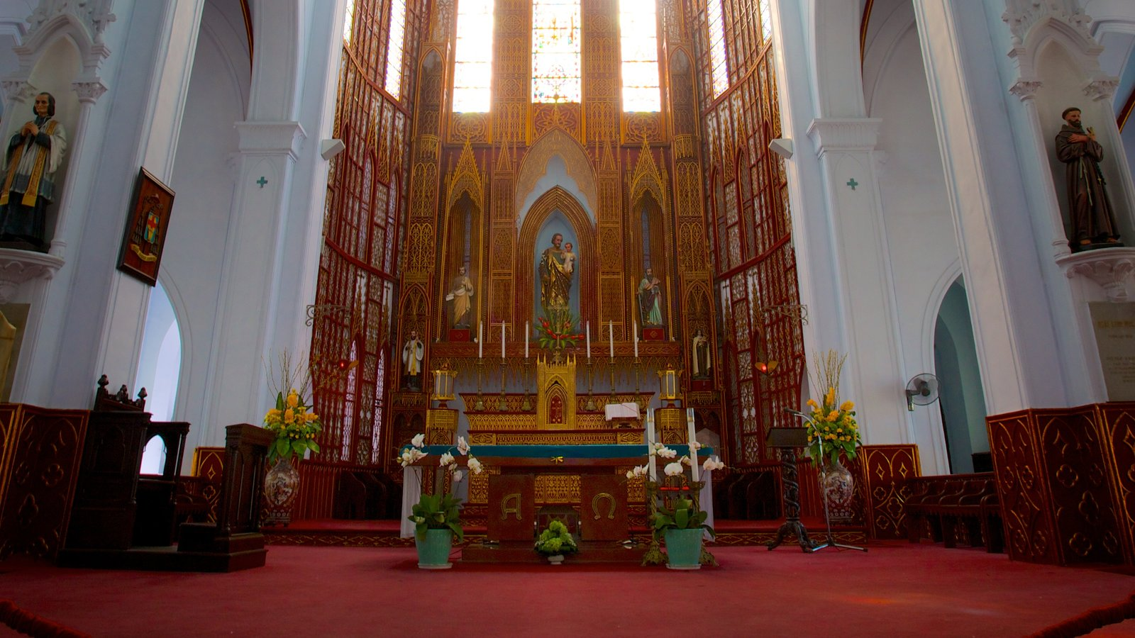 St. Joseph Cathedral featuring a church or cathedral and interior views