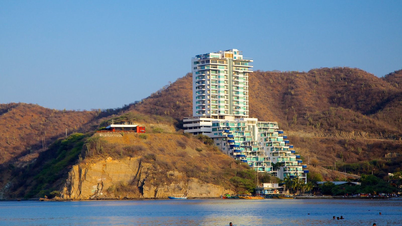 Rodadero Beach Featuring Rugged Coastline A Luxury Hotel Or Resort And General Coastal Views