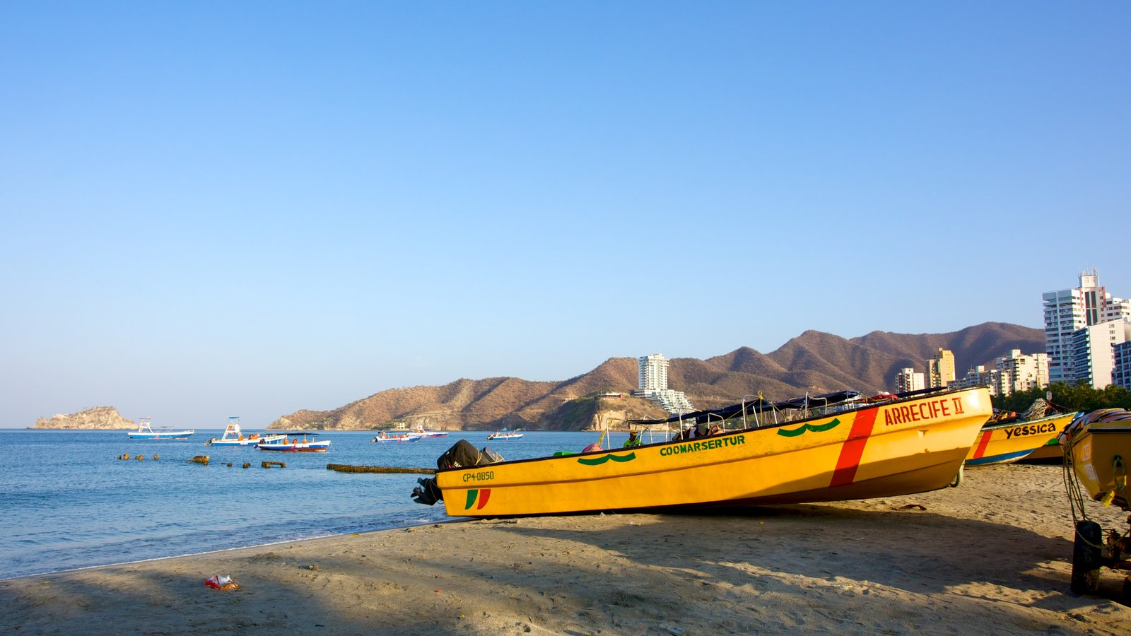 Rodadero Beach featuring boating, a beach and a coastal town