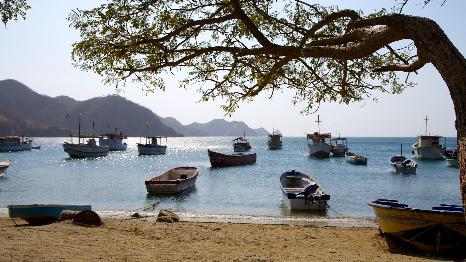 Praia Taganga que inclui canoagem, uma praia e uma baía ou porto