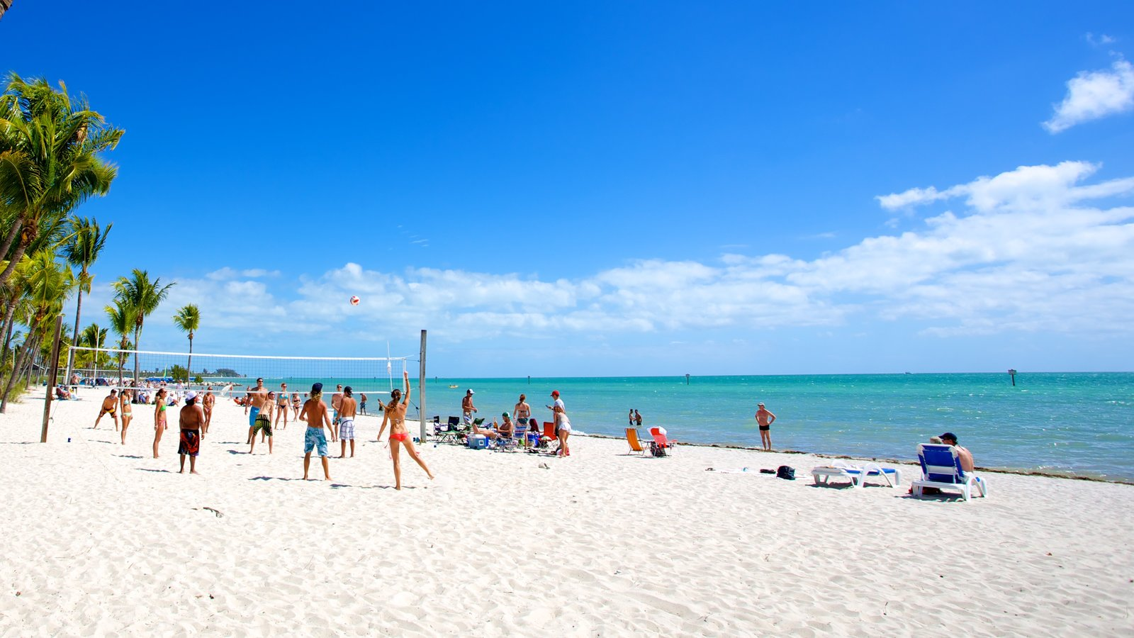 Smathers Beach which includes a sandy beach, tropical scenes and landscape views