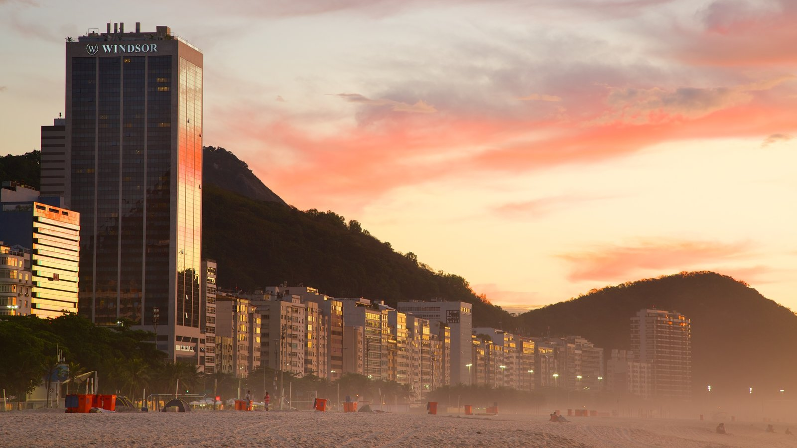 Copacabana Beach which includes a sunset, a beach and a hotel