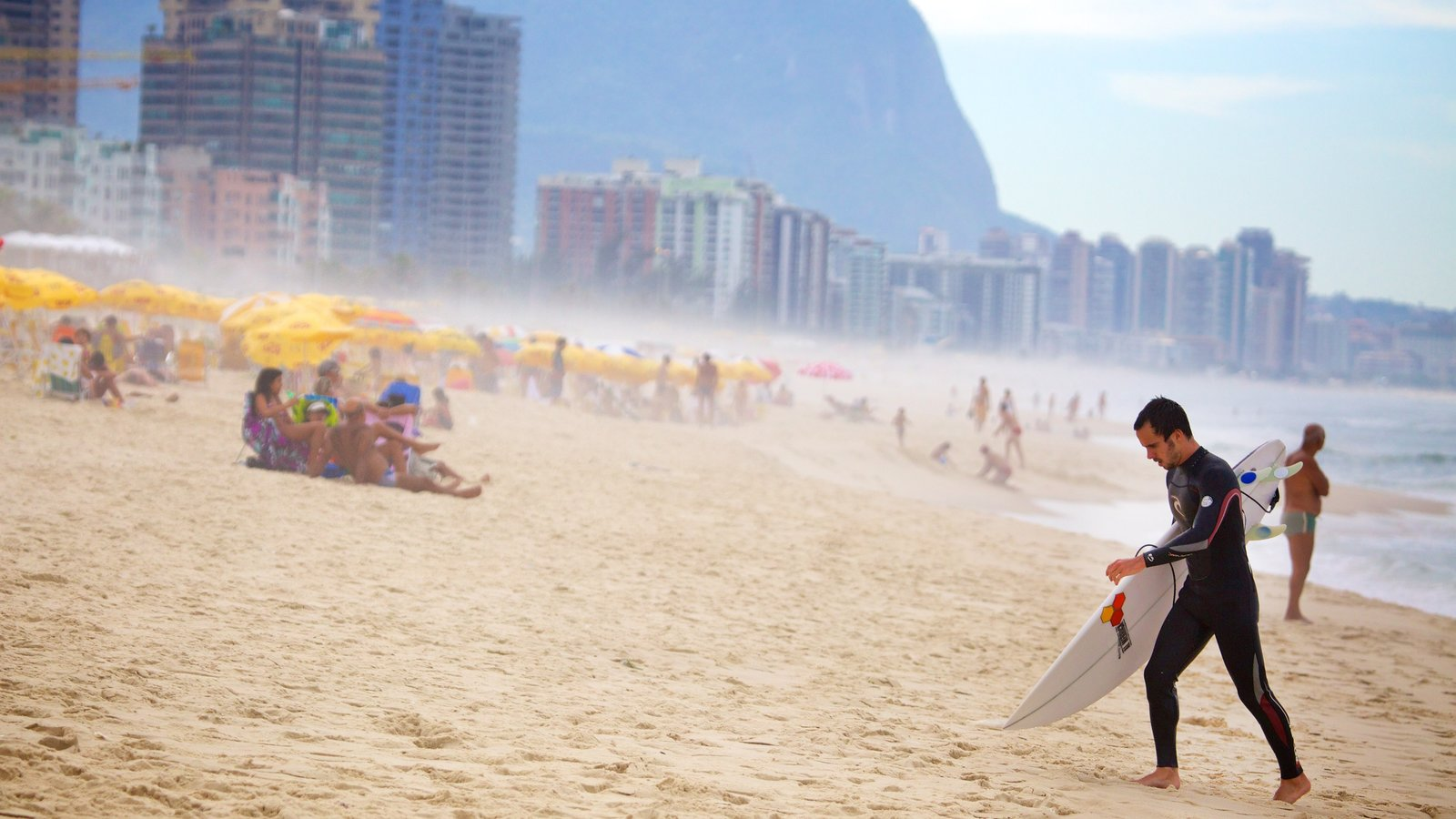 Barra da Tijuca which includes mist or fog and a beach as well as an individual male