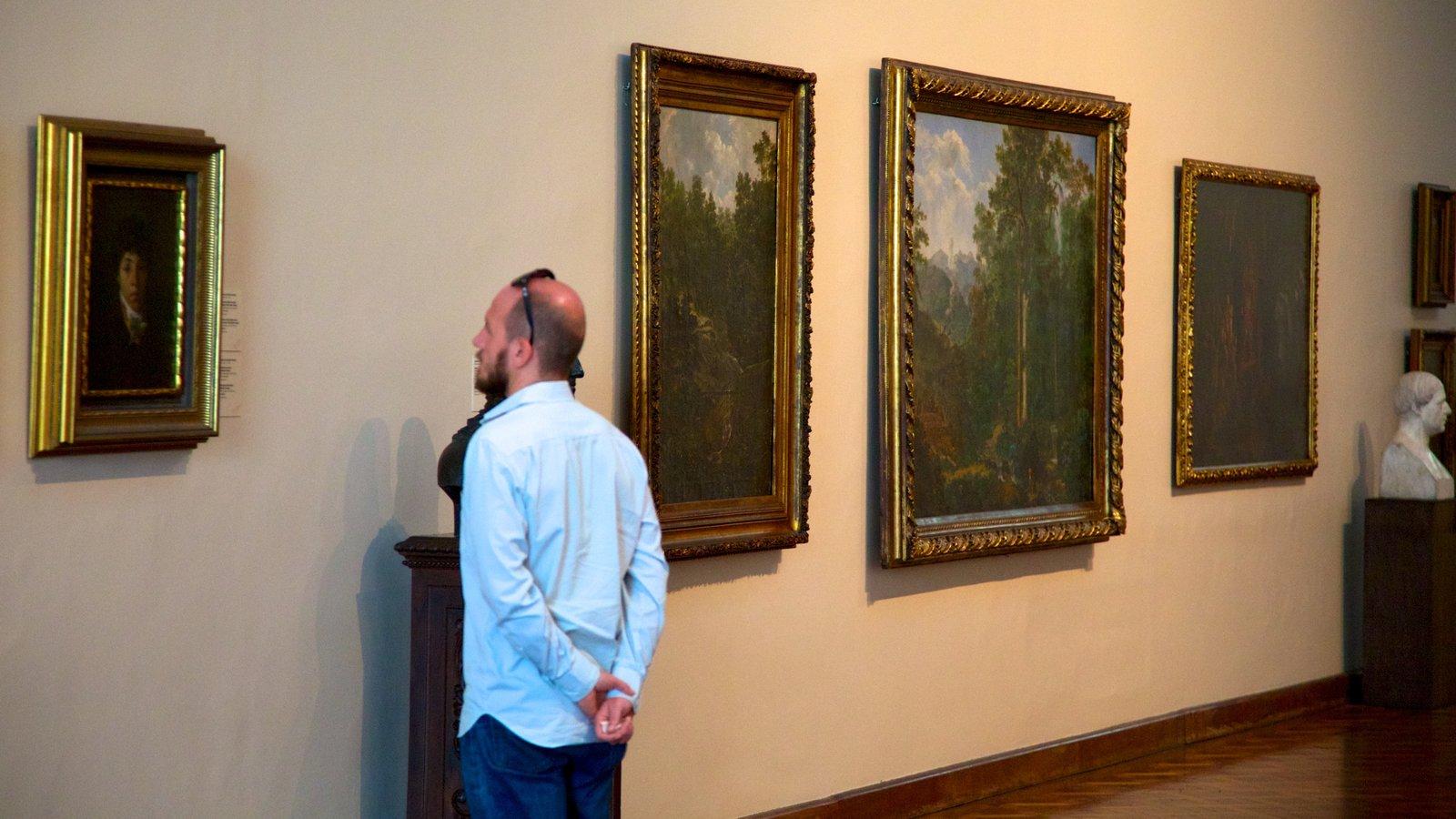 Museu Nacional de Belas Artes mostrando arte e vistas internas assim como um homem sozinho