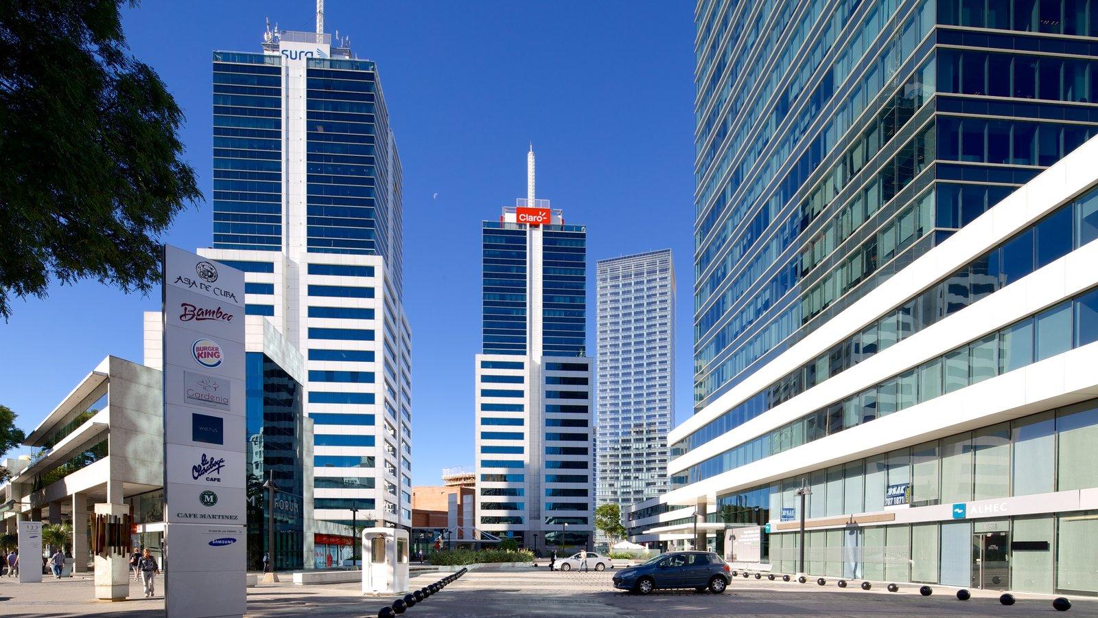 Montevidéu que inclui arquitetura moderna, cenas de rua e um edifício