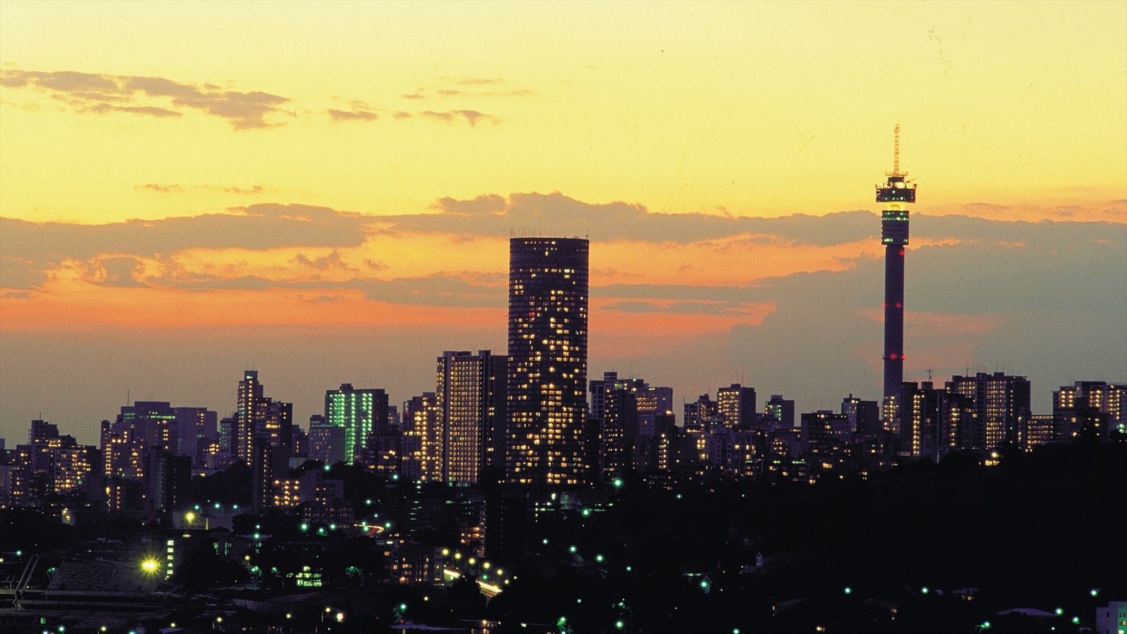 Sunset sunrise pictures view images of johannesburg gauteng johannesburg gauteng showing a city skyline and a high rise building thecheapjerseys Choice Image