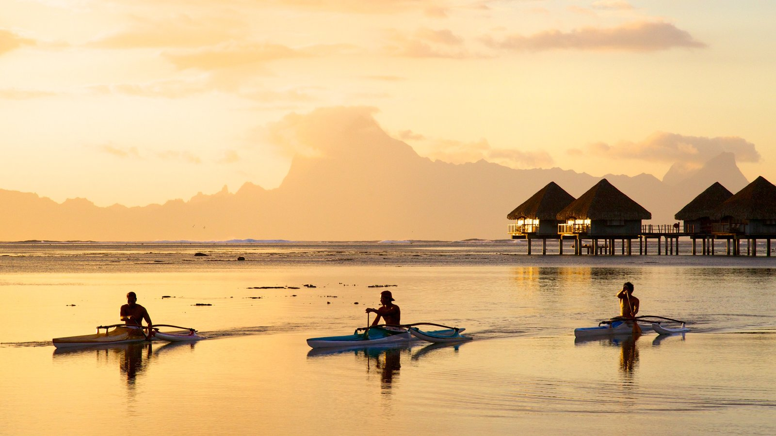 Tahiti featuring kayaking or canoeing, general coastal views and a sunset
