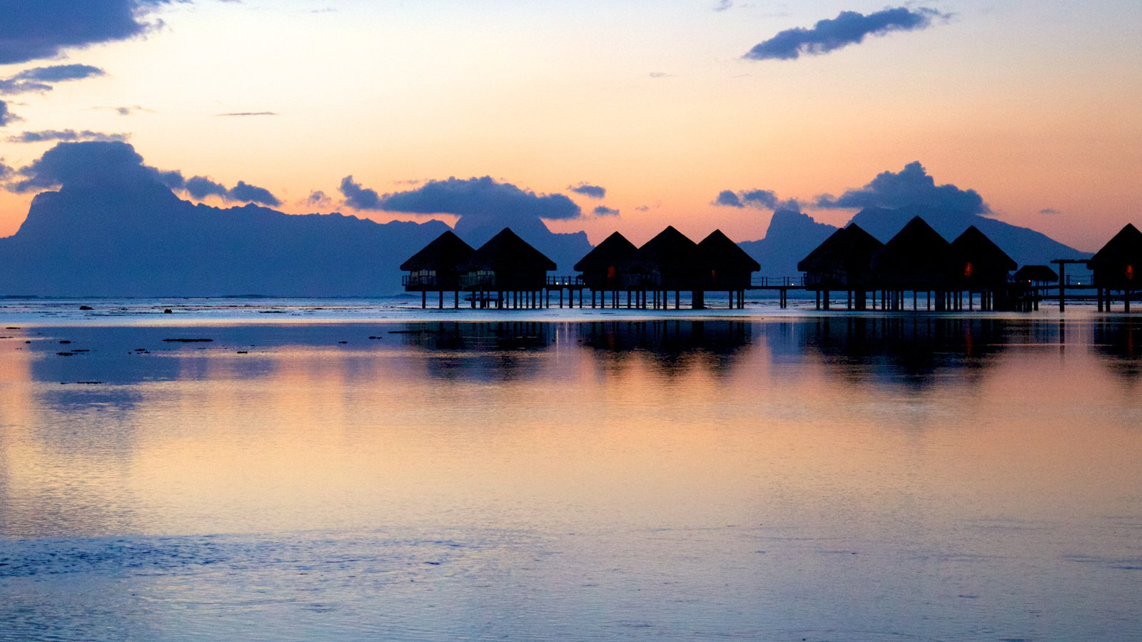 Tahiti which includes a sunset and general coastal views