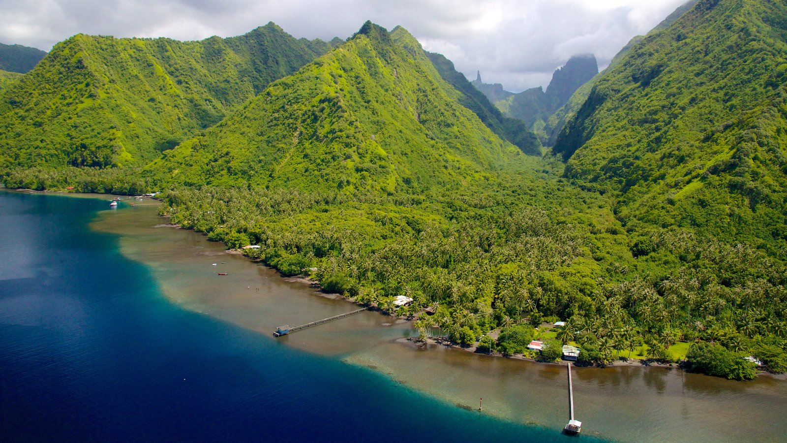 Tahiti featuring mountains and general coastal views