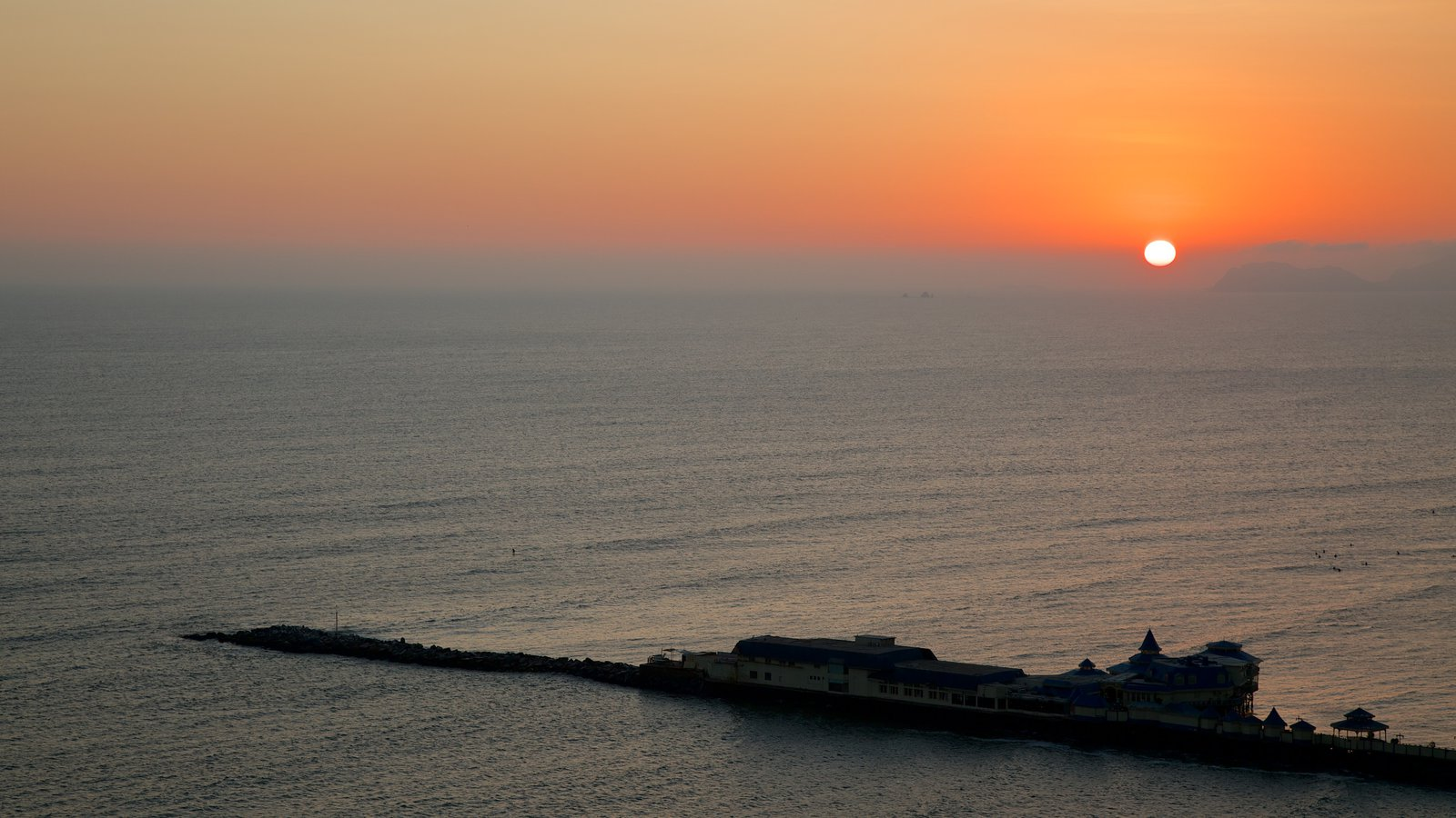 Lima showing a sunset and general coastal views