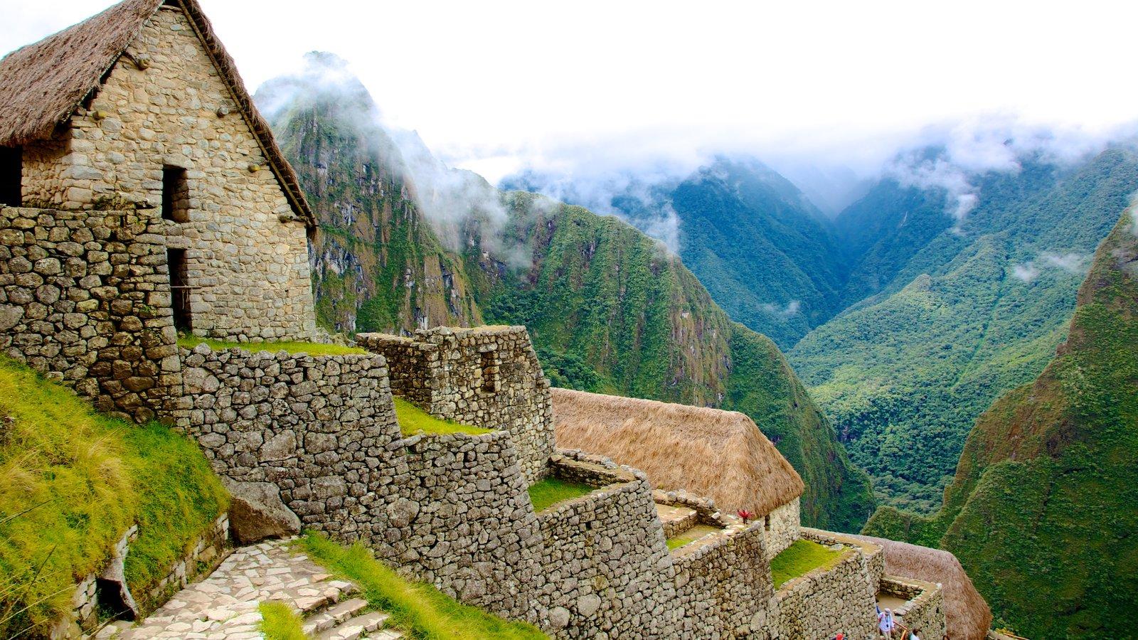 Cuzco mostrando uma casa, uma ruína e arquitetura de patrimônio