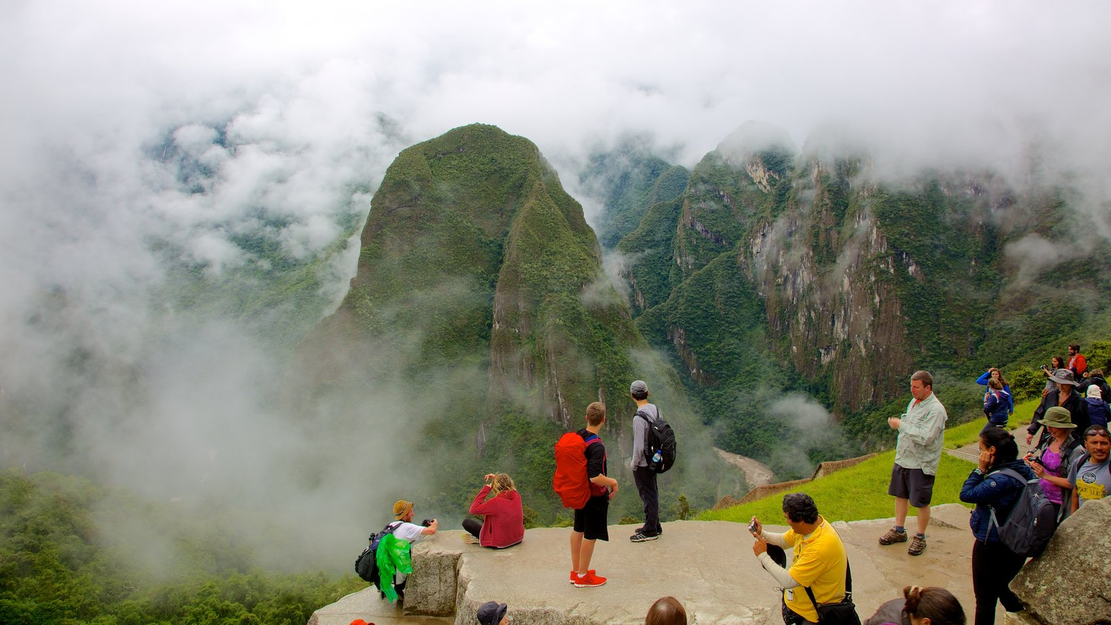 Machu Picchu which includes mountains, mist or fog and hiking or walking
