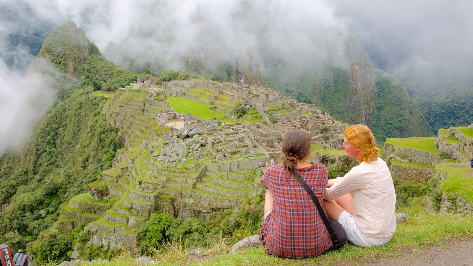 Machu Picchu which includes landscape views as well as a small group of people