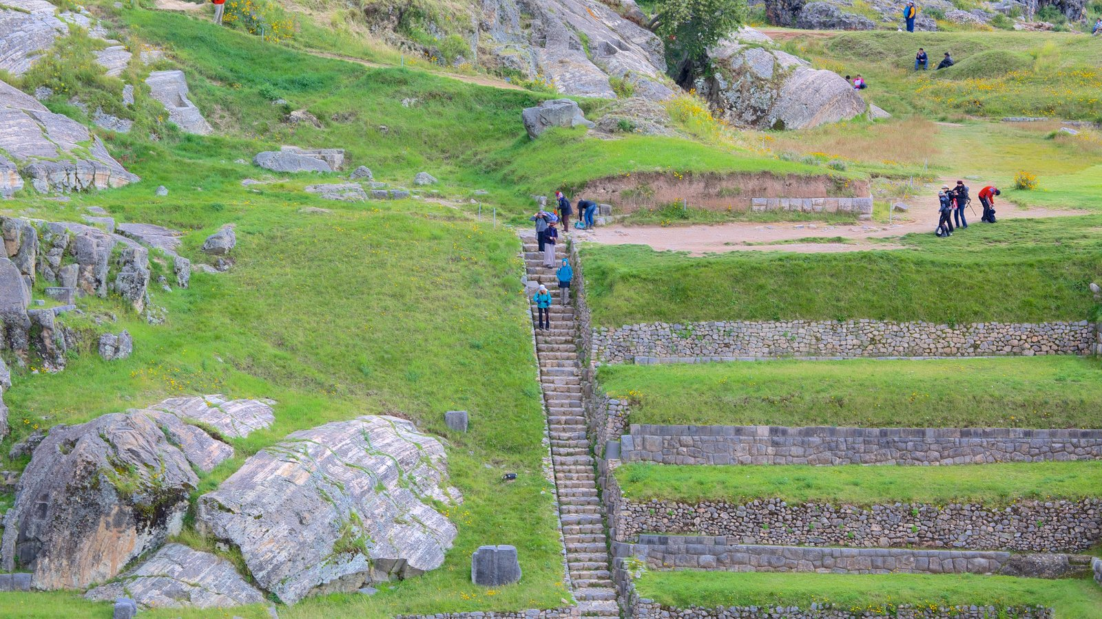 Sacsayhuaman which includes hiking or walking and heritage elements