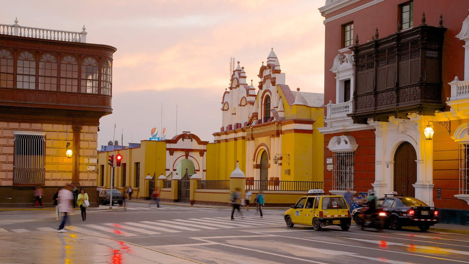 Trujillo Plaza de Armas featuring a sunset, a city and street scenes