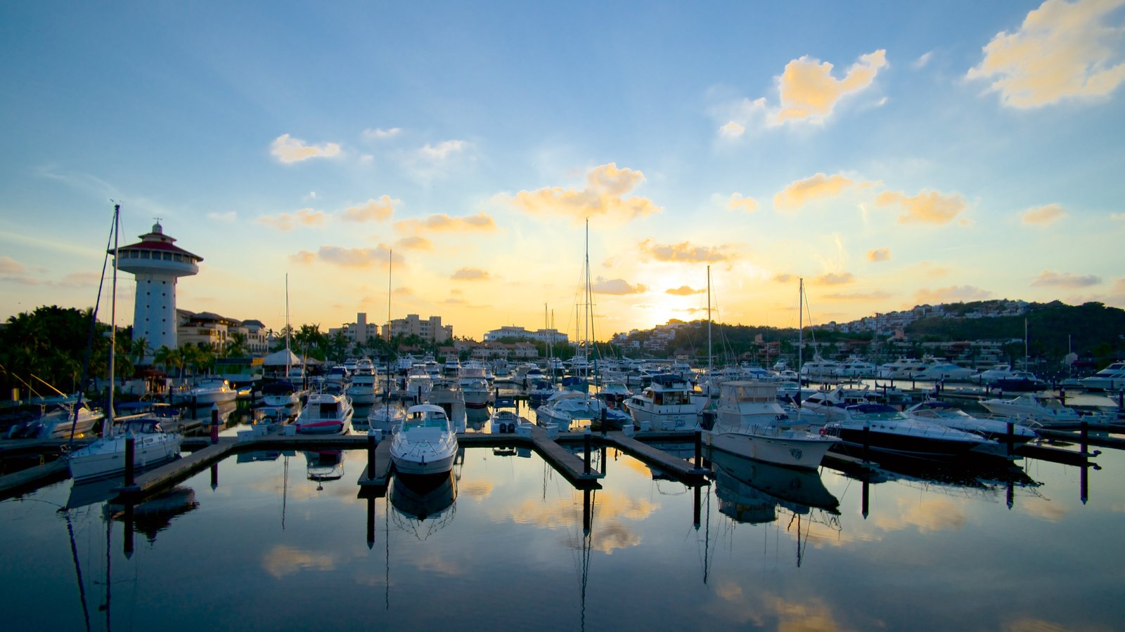 Marina Ixtapa which includes a sunset and a marina