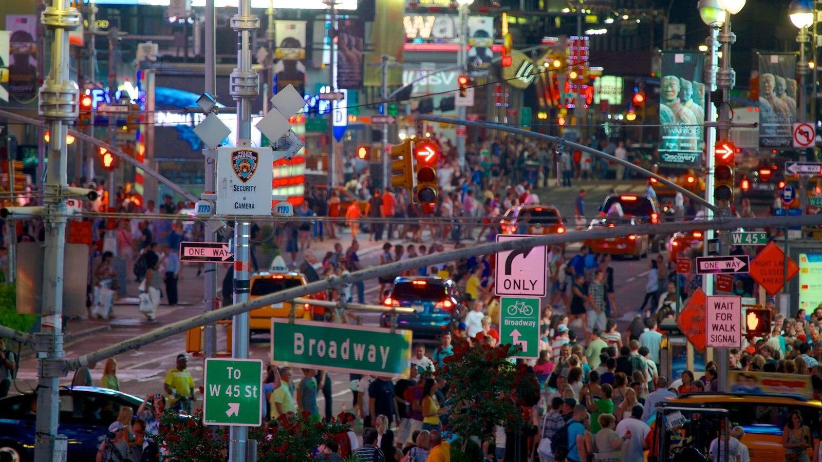 Times Square que inclui cenas noturnas, paisagens da cidade e cenas de rua