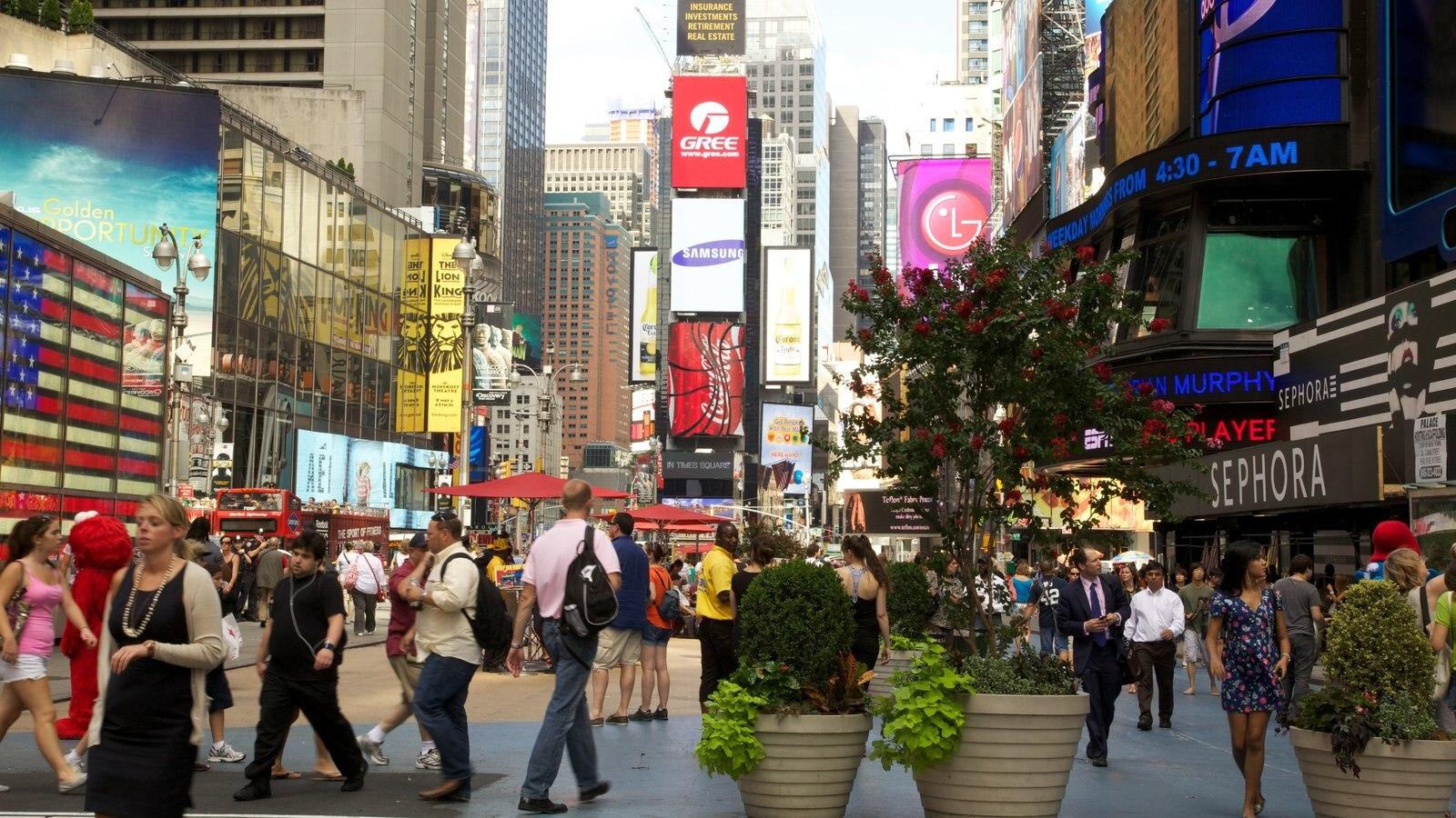 Times Square que inclui uma cidade, cbd e cenas de rua