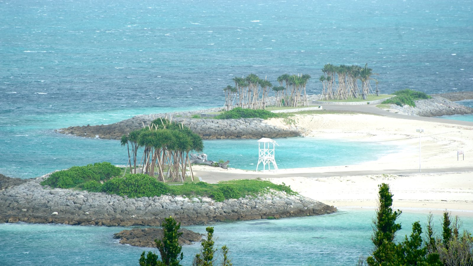 Okinawa Churaumi Aquarium which includes general coastal views and island images
