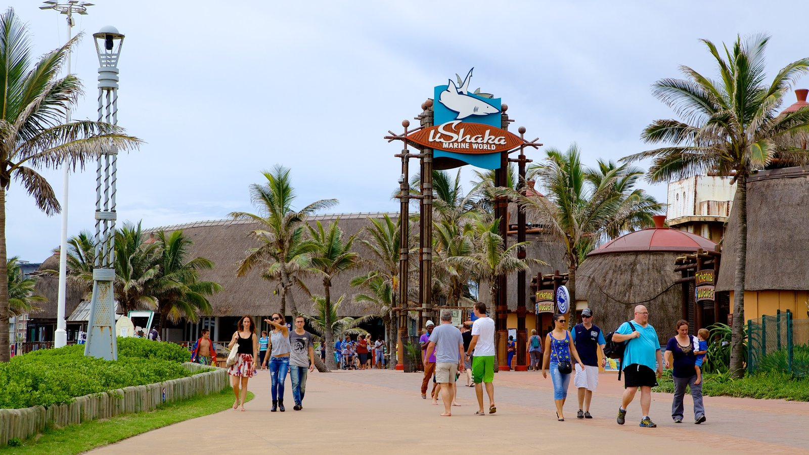 uShaka Marine World featuring signage and rides as well as a large group of people