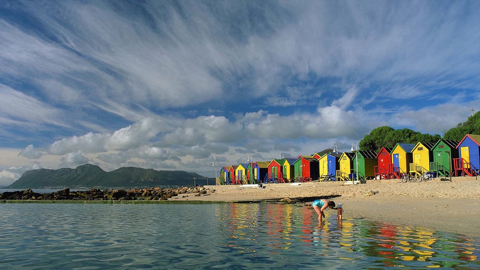 Cape Town featuring a sandy beach and general coastal views as well as a family