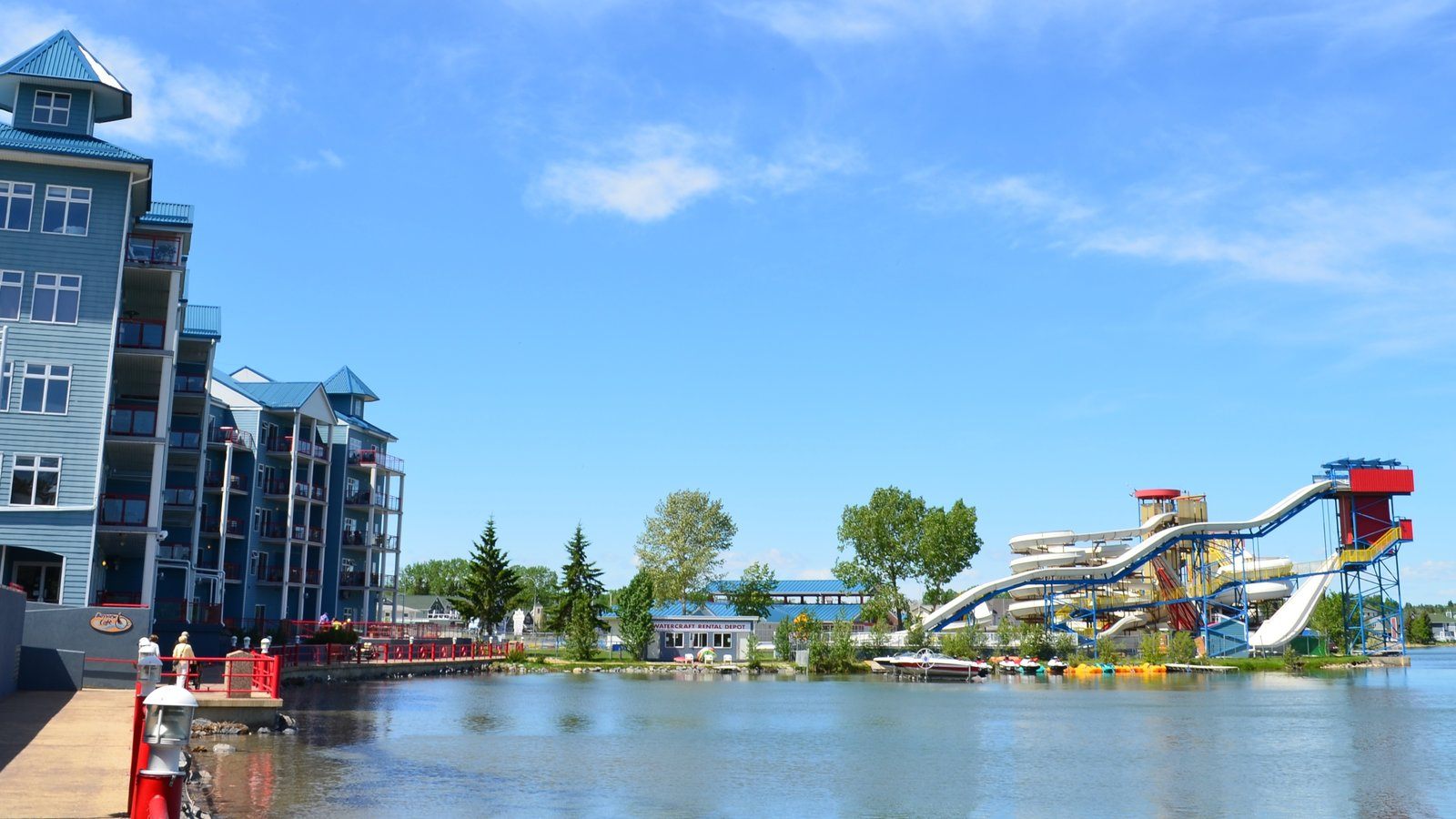Red Deer which includes a lake or waterhole, a water park and rides