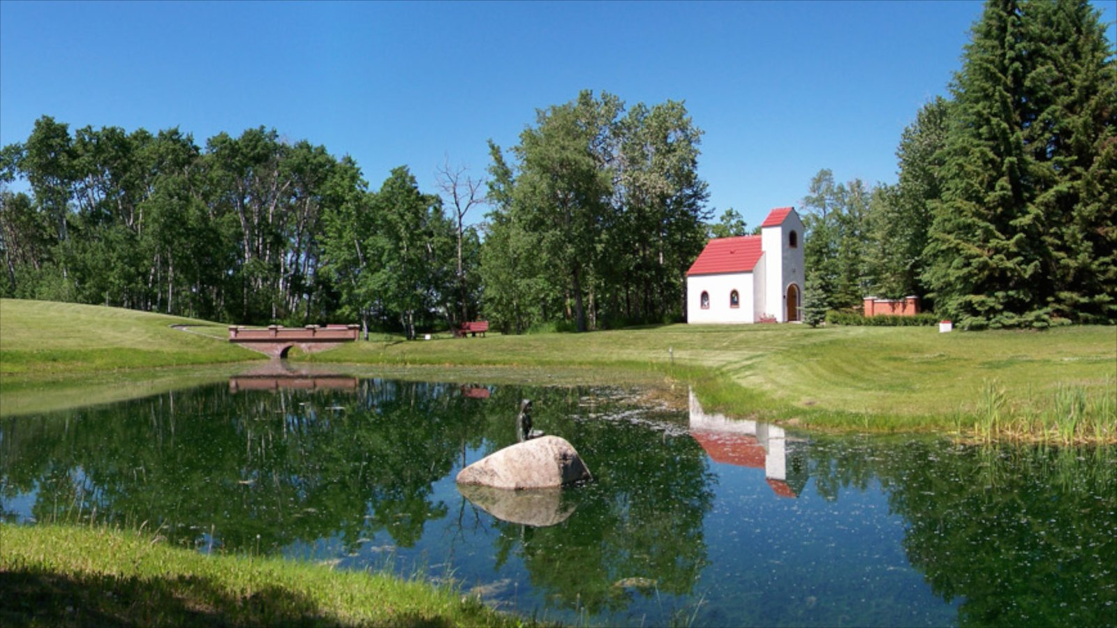 Red Deer featuring a house, landscape views and a pond