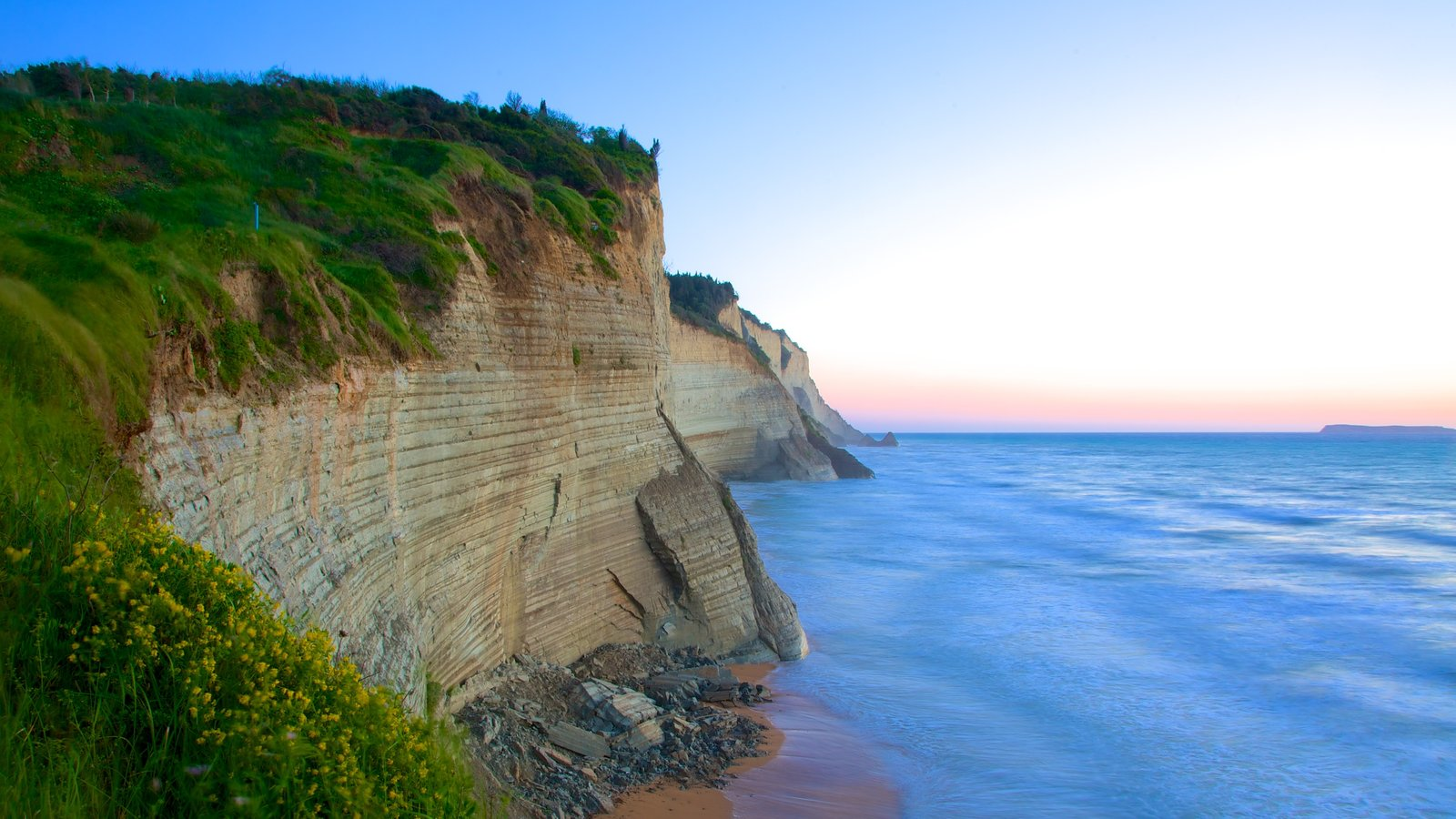 Sunset Beach showing rugged coastline and a sunset