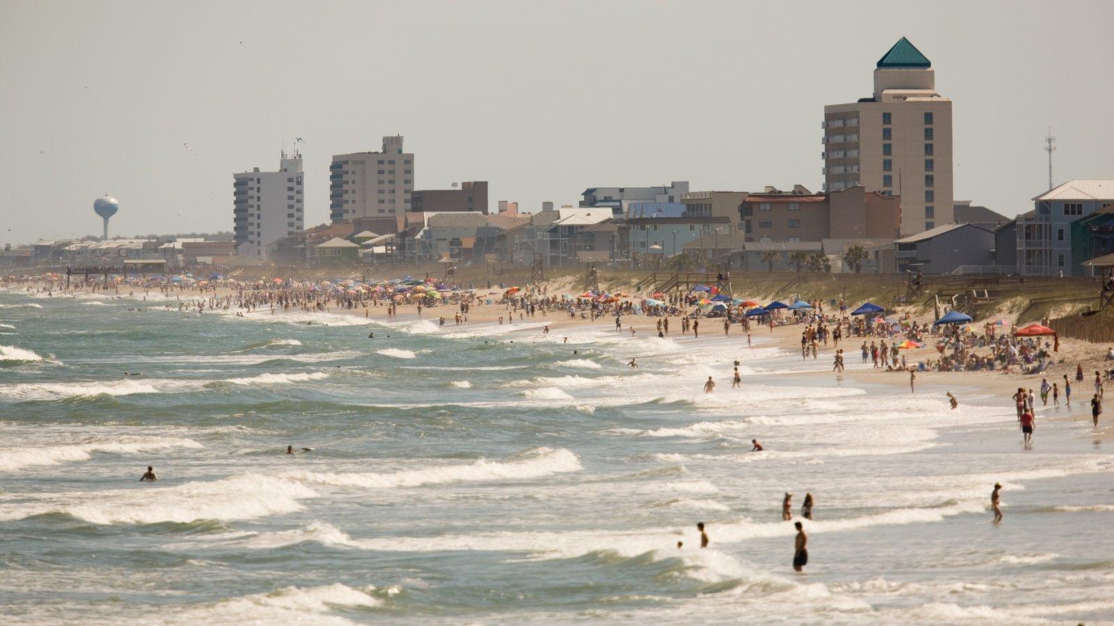 Carolina Beach which includes a beach, surf and a coastal town