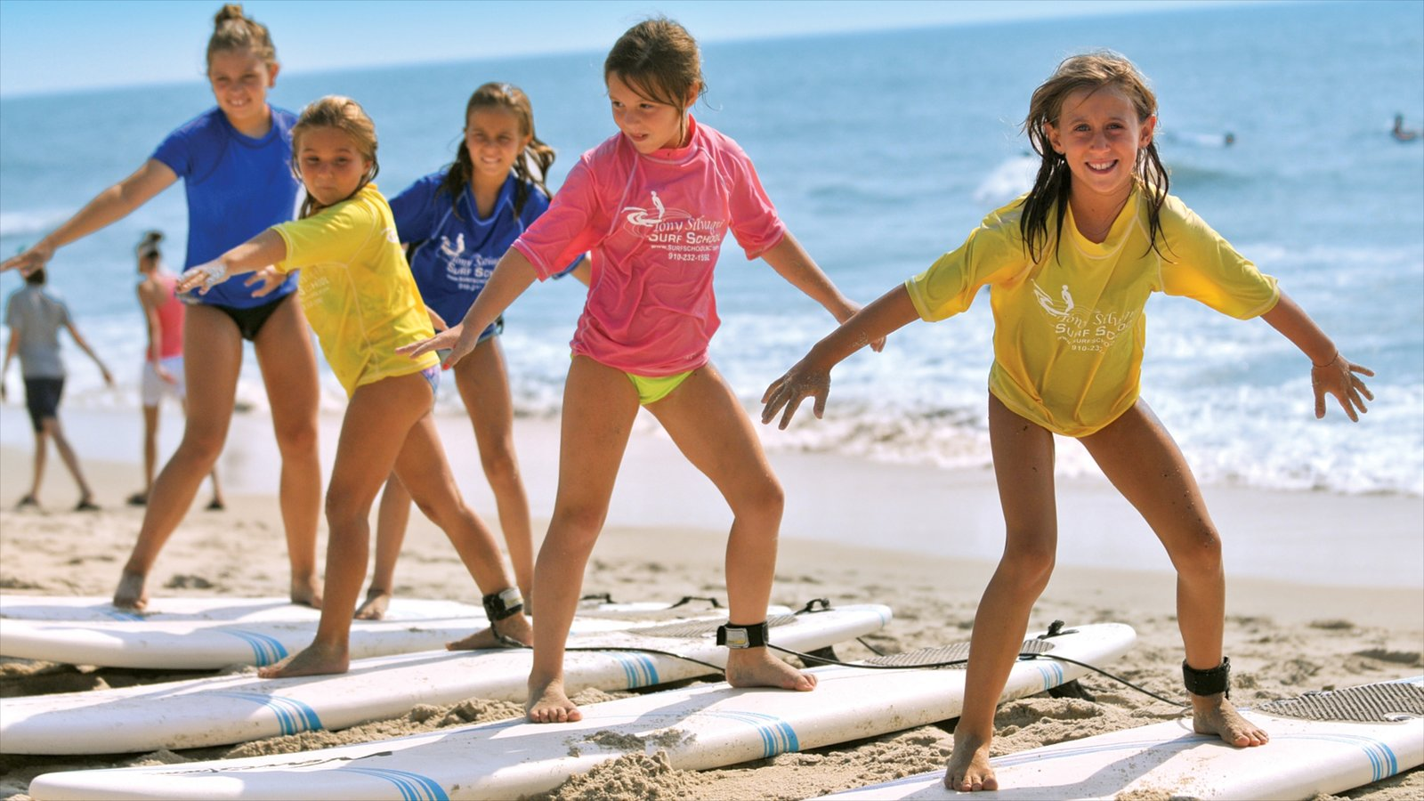 Carolina Beach which includes a sandy beach and surfing as well as children