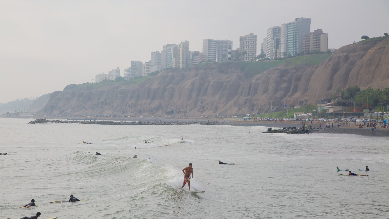Lima showing surf, surfing and general coastal views