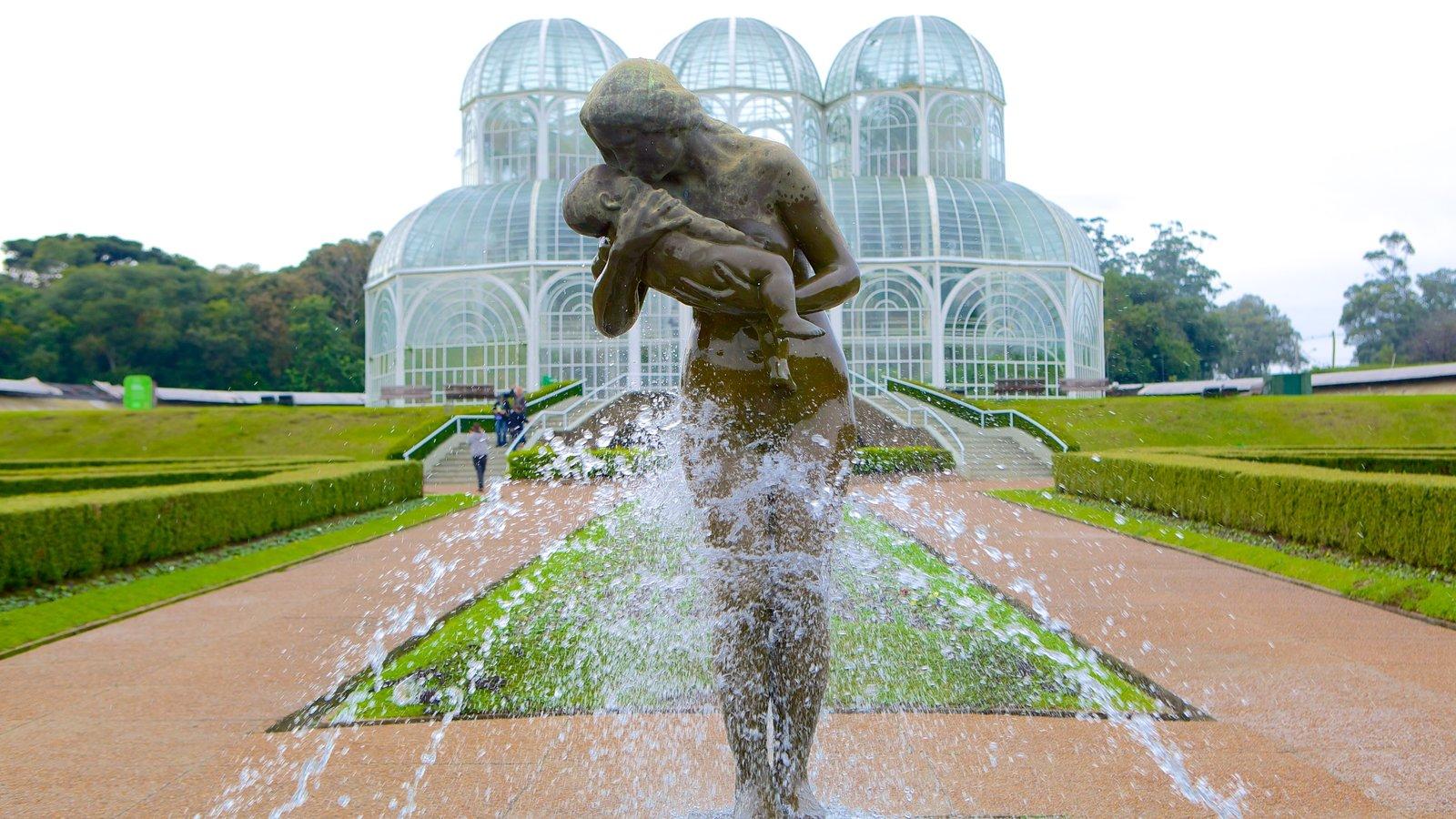 Parque Botânico de Curitiba mostrando um parque, uma fonte e uma estátua ou escultura