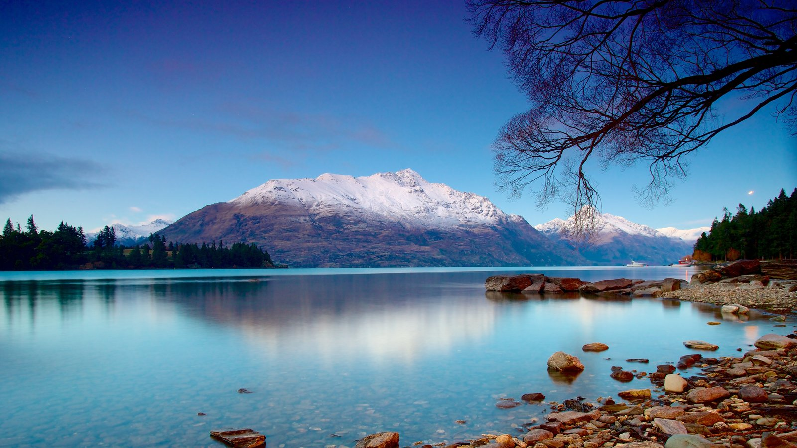 Queenstown featuring landscape views, a pebble beach and mountains