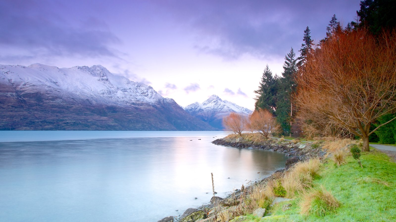 Queenstown featuring a lake or waterhole, autumn leaves and mountains