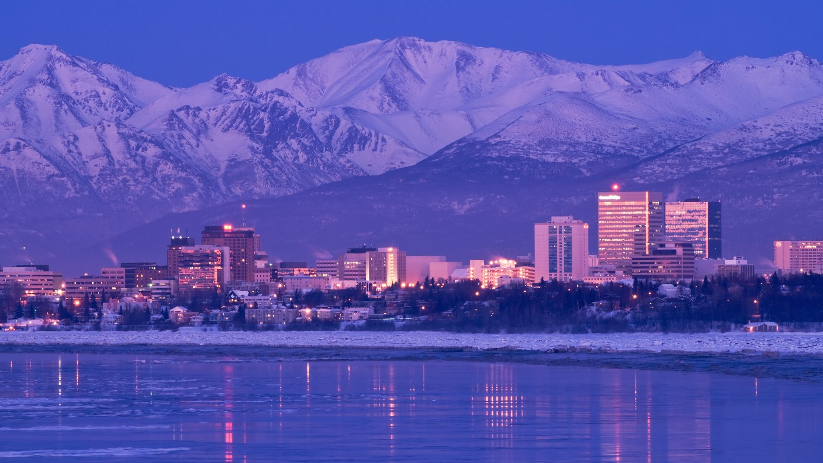Anchorage featuring snow, general coastal views and a city